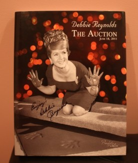 My book of the exhibit signed by Debbie Reynolds