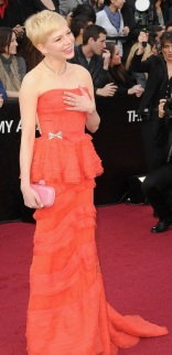 Michelle Williams in a coral Louis Vuitton